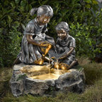 "Jeco - Fratelli Siblings Rock Outdoor/Indoor Fountain with Light - The detailed resin casting used to construct this fountain enables you to enjoy the texture of the children's hair and clothes. The figures feature a painted bronze finish that has been painted to create aged, weathered nuance. The children hold lily pads to create a water cascade with the boy also supporting an adorable frog. The Fratelli Fountain Includes a halogen bulb fixed into the bottom of the water reservoir for a magical nighttime effect. The base has a faux stone finish with green leaf accents. Patented bronze finish figures. Faux stone finish base with green leaf.; Features: Durable polyresin & fiberglass construction; Dimension: 23""L x 19""W x 25""H; Weight: 33 lbs.; Pump included; Electric power; Output: 110V; Line Cord: 10 meters; Weatherproof; For outdoor/indoor use"