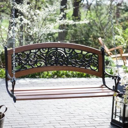 Coral Coast Elegant Curved Back 4-ft. Porch Swing - Enjoy a glass of iced tea on your front porch and enjoy summer breezes with the Coral Coast Elegant Curved Back 4-ft. Porch Swing. This charming classic swing features solid fir construction with a slatted seat and ornate iron cut-out designs finished in wrought-iron black. This set comes with two options: swing only or swing with hanging kit included. Hardware is zinc-plated and clear-coated and has rust-resistant hooks for years of quality use. About Coral CoastWhat if when you closed your eyes you pictured yourself in your own backyard? Coral Coast has a collection of easygoing affordable outdoor furniture and accessories for your patio pool and backyard. The latest colors and styles mingle with true classics in durable materials and weather-worthy fabrics ready for relaxation. Make yours a life of leisure.