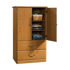 Sauder - Orchard Hills Storage Armoire in Carolina Oak - 2 Adjustable shelves behind doors. 2 Drawers with metal runners and safety stops. Patented T-lock assembly system. Made of engineered wood. Assembly required. 31 in. W x 21 in. D x 55 in. H