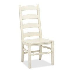 Wynn Ladderback Side Chair, French White - Originally a European design based on the Windsor chair, the ladderback chair has since become an American icon. Our Wynn Ladderback Chair is crafted in the Shaker tradition with a scooped contoured seat. Masterfully crafted from kiln-dried hardwood. Generously sized to coordinate with Pottery Barn's largest dining tables. Distressed by hand for rich character. Wood swatches, below, are available for $25 each. We will provide a merchandise refund for wood swatches if they're returned within 30 days. Side chair is sized for use with our large PB Classic Dining Cushion. Select items are Catalog / Internet Only. View our {{link path='pages/popups/fb-dining.html' class='popup' width='480' height='300'}}Furniture Brochure{{/link}}.