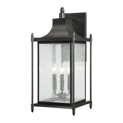 Dunnmore Wall Mount Lantern - Dunnmore has classic American styling with clean lines, a Black finish and rustic Seeded Glass. Weight: 8. 80 lbsFinish: BlackBulb Wattage: 40Glass: Clear SeededNumber of Bulbs: 3Candle Covers: Black MetalType of Bulb: CBulbs Included: NoBackplate Width: 6. 50Backplate Height : 12. 25Safety Rating: UL, CULUL Wet/Damp Location: UL Wet LocationVoltage: 120