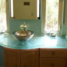 vessel and glass top, windows and blond vanity