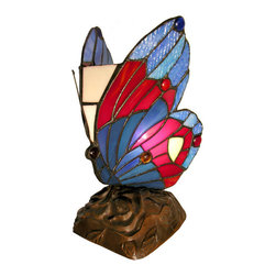 Warehouse of Tiffany - Tiffany Style Blue Butterfly Accent Lamp - This unique stained-glass accent lamp provides a one-of-a-kind lighting option for your home. The beautiful shades of red and blue glow softly through this beautiful, compact Tiffany-style lamp. This cheerful butterfly light is sure to make you smile!