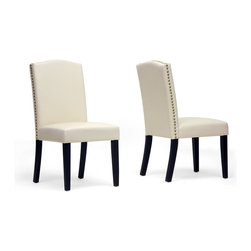 "Baxton Studio - Baxton Studio Trullinger Beige Modern Dining Chair (Set of 2) - Trullinger is a handsome classic prevalent with timeless charm. This designer dining chair is made with a wooden frame, foam cushioning, and beige faux leather upholstery. Chinese-made, the Trullinger Dining Chair is finished with antiqued brass nail head trim along the edges as well as black lacquer legs with non-marking feet. Keep stains and spills at bay by wiping this chair clean easily with no more than a damp cloth. The Trullinger Modern Dining Chair is also offered in dark brown (sold separately). Assembly is required.  19.12""W x 25""D x 38.25""H, seat dimension: 19.12""W x 18.37""D x 19.12""H"