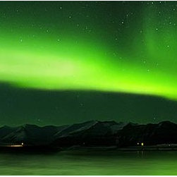 Magic Murals - Aurora Polaris Panorama Wall Mural -- Self-Adhesive Wallpaper by MagicMurals - An aurora polaris is a high-altitude aurora borealis.  This mural captures the ghostly green glow of the Northern Lights near the Arctic Circle as they reflect off the lake below.