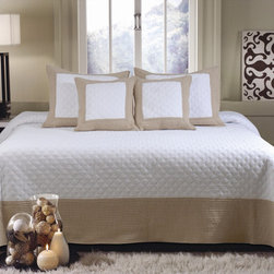 None - Brentwood Deluxe Ivory/Taupe 5-piece Bedspread Set - Two different quilting patterns add subtle interest to this taupe and ivory bedspread set: double diamonds on the center panel and channel stitching on the border. White/taupe border on one side reverses to taupe/white border on the other.