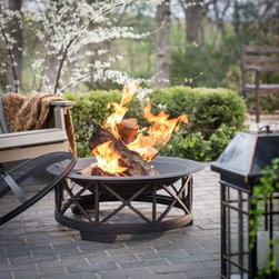 Fire Sense 30 in. Portsmouth Black Fire Pit - There's nothing like a cozy night around the Fire Sense 30 in. Portsmouth Black Fire Pit with friends or family. Enjoy the safe glow and warmth of a fire in the comfort of your own backyard. This fire pat has a durable black steel bowl that sits atop a decorative powder-coated base providing you with years of lasting beauty and enjoyment. The one-piece dome spark screen includes a screen lift tool for safety. About Well Traveled LivingWell Traveled Living is a designer importer and distributor of outdoor living products. Established in 1998 they introduced clay chimineas to the United States and now offer a full range of innovative outdoor heating patio and garden products under the Fire Sense and Patio Sense brand names. Their Florida customer service center provides unsurpassed service and support for all of our products.