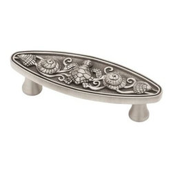 """Liberty Hardware - Liberty Hardware PBF663-BSP-C Seaside Cottage Cab HW-Libert 1.23"""" Handle Pull - This whimsical pull from the Seaside Cottage collection captures the beauty of the sea by incorporating a turtle with shells atop scrollwork reminiscent of ocean waves. Perfect for adding the feeling of a beach-side retreat to your kitchen or bath. Multiple finishes available. Center to Center - 3 Inch, Width - 1.23 Inch, Height - 4.13 Inch, Projection - 1.39 Inch, Finish - Brushed Satin Pewter, Weight - 0.23 Lbs."""
