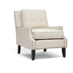 Baxton Studio - Norwich Beige Linen Modern Lounge Chair - Modern enough to go contemporary, yet classic enough to be in a traditional setting, this is clearly a designer chair that belongs in your space. The tufted linen backrest, bronze nailhead trim and black wooden frame are details that give this chair the elegant luxury you're looking for in a lounge chair. Simply perfect.