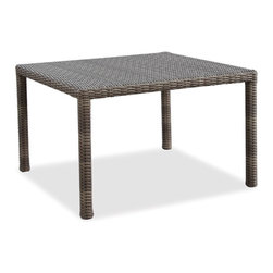Thos. Baker - Wicker Outdoor Square Dining Table | Hampton Collection - Oversized seating in all-weather wicker with a slightly weathered look inspired by classic whitewashed country home styles. Premium, dyed-through resin wicker with an extra large diameter profile and elegant ocean gray finish. Powder-coated aluminum subframe and brushed aluminum feet.Plush Sunbrella cushion sets included where applicable. Choose quick ship in khaki with cocoa piping, stone green or choose from our made-to-order fabric options.Made-to-order cushion sales are final and ship in 2-3 weeks.Dining tables do not have holes for umbrellas. All dining tables ship with tempered glass.