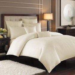 Nicole Miller - Nicole Miller Currents Pearl King Size Sham - An abundance of tactile texture, this Nicole Miller Currents king size sham embraces a tone-on-tone wave pattern for sumptuous shape and dimension. An elegant coordinate for the bedding.