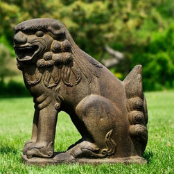 Campania International Temple Foo Dog Looking Left Garden Statue - Large - About Campania InternationalEstablished in 1984, Campania International's reputation has been built on quality original products and service. Originally selling terra cotta planters, Campania soon began to research and develop the design and manufacture of cast stone garden planters and ornaments. Campania is also an importer and wholesaler of garden products, including polyethylene, terra cotta, glazed pottery, cast iron, and fiberglass planters as well as classic garden structures, fountains, and cast resin statuary.Campania Cast Stone: The ProcessThe creation of Campania's cast stone pieces begins and ends by hand. From the creation of an original design, making of a mold, pouring the cast stone, application of the patina to the final packing of an order, the process is both technical and artistic. As many as 30 pairs of hands are involved in the creation of each Campania piece in a labor intensive 15 step process.The process begins either with the creation of an original copyrighted design by Campania's artisans or an antique original. Antique originals will often require some restoration work, which is also done in-house by expert craftsmen. Campania's mold making department will then begin a multi-step process to create a production mold which will properly replicate the detail and texture of the original piece. Depending on its size and complexity, a mold can take as long as three months to complete. Campania creates in excess of 700 molds per year.After a mold is completed, it is moved to the production area where a team individually hand pours the liquid cast stone mixture into the mold and employs special techniques to remove air bubbles. Campania carefully monitors the PSI of every piece. PSI (pounds per square inch) measures the strength of every piece to ensure durability. The PSI of Campania pieces is currently engineered at approximately 7500 for optimum strength. Each piece is air-dried and then de-molded by hand. After an internal quality check, pieces are sent to a finishing department where seams are ground and any air holes caused by the pouring process are filled and smoothed. Pieces are then placed on a pallet for stocking in the warehouse.All Campania pieces are produced and stocked in natural cast stone. When a customer's order is placed, pieces are pulled and unless a piece is requested in natural cast stone, it is finished in a unique patinas. All patinas are applied by hand in a multi-step process; some patinas require three separate color applications. A finisher's skill in applying the patina and wiping away any excess to highlight detail requires not only technical skill, but also true artistic sensibility. Every Campania piece becomes a unique and original work of garden art as a result.After the patina is dry, the piece is then quality inspected. All pieces of a customer's order are batched and checked for completeness. A two-person packing team will then pack the order by hand into gaylord boxes on pallets. The packing material used is excelsior, a natural wood product that has no chemical additives and may be recycled as display material, repacking customer orders, mulch, or even bedding for animals. This exhaustive process ensures that Campania will remain a popular and beloved choice when it comes to garden decor.