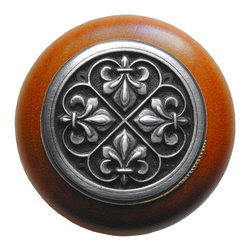 "Inviting Home - Fleur-de-Lis Cherry Wood Knob (antique pewter) - Fleur-de-Lis Cherry Wood Knob with hand-cast antique pewter insert; 1-1/2"" diameter Product Specification: Made in the USA. Fine-art foundry hand-pours and hand finished hardware knobs and pulls using Old World methods. Lifetime guaranteed against flaws in craftsmanship. Exceptional clarity of details and depth of relief. All knobs and pulls are hand cast from solid fine pewter or solid bronze. The term antique refers to special methods of treating metal so there is contrast between relief and recessed areas. Knobs and Pulls are lacquered to protect the finish. Alternate finishes are available. Detailed Description: The Fleur-de-lis means ""flower of the lily"" It was used to represent French royalty. It was said that the king of France Clovis who started using the symbol of the Fleur-de-lis because the water lilies helped guide him to safety and aided him in winning a battle. The design in the Fleur-de-Lis pulls is arranged in alternating positions of the Fleur-de-lis. These pulls are a great match for the Fleur-de-lis knobs which have the Fleur-de-lis pattern arranged in a circle. The different shapes of decorative hardware make the cabinet doors and drawers interesting to look at."