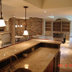 Spaces are created by soffits, half walls, and columns. Arched drywall
