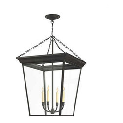 Cornice Hanging Lantern - An oversized lantern is a great way to add striking and unexpected lighting to your dining table, entryway, or kitchen island. This traditional piece is a pendant/chandelier hybrid that will wow you with its scale and light.