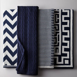 Horchow - Cable-Knit Navy Cotton Throw - Throws are a great way to add color and pattern to a solid-color chair or sofa, but we also like the element of cozy comfort they bring to the mix. Consider adding one to a reading chair in the guest room to make it especially welcoming. Available in (s...
