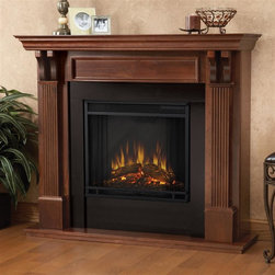 Real Flame - Ashley Indoor Electric Fireplace in Mahogany - 1400 Watt heater, rated over 4700 BTUs per hour. Programmable thermostat with display in Fahrenheit or Celsius. Ultra Bright LED technology with 5 brightness settings. Digital readout display with up to 9 hours timed shut off. Dynamic ember effect. Fireplace includes wooden mantel, firebox, screen, and remote control.. Solid wood and veneered MDF construction. 48.03 in. W x 13.78 in. D x 41.25 in. H (107 lbs.)Best selling item! Handsome pillars with curved supports create an understated elegance in any room. The Vivid Flame Electric Firebox plugs into any standard outlet for convenientset up. The features include remote control, programmable thermostat, timer function, brightness settings and ultra bright Vivid Flame LED technology.