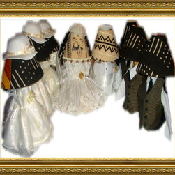 "The Wedding Gift 1 8pc set - TEDDEEZtm Mud cloth Lamps has Bride Lamp dressed in beautiful white dress with pretty gold flowers. The shade has real hair and removable hat with veil. One side is white brocade while the other is white mud cloth. Gold tone bells and fertility pieces accessorize its edges. Undress the base to white mud cloth on one side with black print. Adorned with champagne bottle and glass, brooms, white doves, our wedding day ribbon. Turn it around you have black mud cloth with white stripes. The Groom wears a sharp White three piece suit, and carries cowrie shells and rings in the hands. The shade is white mud cloth, its edges have gold tone bells. The base is white mud cloth with black print on one side and black mud cloth with white stripes on the opposite side. The front has champagne, with burgundy butterflies in the champagne glass. The Brides maids are dressed in darling off white dresses and little matching removable bonnets. Undress each of them to gold, rust and black mud cloth. One side has champagne glass and bottle, rings and brooms. Each shade matches the base. The Groomsmen are rust, gold and black mud cloth. champagne bottle and glass accessorizes one side, including gold tone bell. Each comes with matching shade. Lamps can be displayed in numerous ways. With cloths, with or without hair and veil, without cloths, all white, all black, white top black bottom, black top white bottom. Each lamp Stands 18""h, has a glass base and uses a 60 watt bulb, made in the U.S.A.. The gift that will be talked about for years to come. Comes separately also."