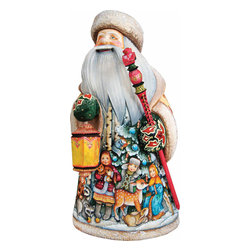 """Artistic Wood Carved Santa Claus Lighting Way Sculpture - Measures 12""""H x 5.25""""L x 4.75""""W and weighs 4 lbs. G. DeBrekht fine art traditional, vintage style sculpted figures are delightful and imaginative. Each figurine is artistically hand painted with detailed scenes including classic Christmas art, winter wonderlands and the true meaning of Christmas, nativity art. In the spirit of giving G. DeBrekht holiday decor makes beautiful collectible Christmas and holiday gifts to share with loved ones. Every G. DeBrekht holiday decoration is an original work of art sure to be cherished as a family tradition and treasured by future generations. Some items may have slight variations of the decoration on the decor due to the hand painted nature of the product. Decorating your home for Christmas is a special time for families. With G. DeBrekht holiday home decor and decorations you can choose your style and create a true holiday gallery of art for your family to enjoy. All Masterpiece and Signature Masterpiece woodcarvings are individually hand numbered. The old world classic art details on the freehand painted sculptures include animals, nature, winter scenes, Santa Claus, nativity and more inspired by an old Russian art technique using painting mediums of watercolor, acrylic and oil combinations in the G. Debrekht unique painting style. Linden wood, which is light in color is used to carve these masterpieces. The wood varies slightly in color."""