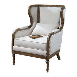 """Uttermost Neylan Linen Wing Chair - Soft, neutral linen tailoring on the exposed solid pine frame in weathered walnut finish, accented by individually hammered, antique brass nails.  Pillow reverses to a pale beige stripe. Soft, neutral linen tailoring on the exposed solid pine frame in a weathered walnut finish, accented by individually hammered, antique brass nails. Pillow reverses to a pale beige stripe. Seat height is 19.25""""."""