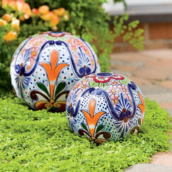 Handmade Talavera-Inspired Ceramic Globes - Bring some color to the party with these stunning ceramic globes. Nestled in greenery, they are the perfect punch of pretty for a more minimalist garden.