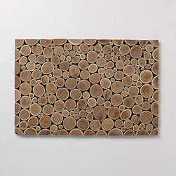 Tree Trimmings Doormat - I love the look of this doormat — it's a simple cross section of tree branches. The woodsy texture is so pretty.