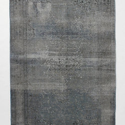 Awash Rug - I think a subtle rug would be needed in a room with a lot of color. I love the worn-in feeling of this one.