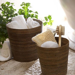 """Wastebaskets - Bathroom Accessories - Enhance your bathroom aesthetic with the natural color hues of  Calaisio`s wastebasket made of Nito vines which live up to the most luxurious surroundings making it a great choice to compliment many themes and styles from French Country, Rustic Tuscan, Vintage and more.  Available in 2 sizes. Small 9""""Diameter x 9""""H.  Medium  11""""Diameter x 11""""H."""