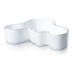 """iittala - Alvar Aalto White Bowl - A shape constantly interpreted, the Alvar Aalto collection of vases stays true to the original design concept. More than 70 years after the original debut, the design continues to provoke attention by letting the owner decide its use and complementing our busy lives with a touch of nature. Filled with fresh cut flowers or arranged with other collection pieces as works of art, this eternal classic is essential to the modern home. The Aalto glass pieces have a multi-stage production. The non-leaded crystal is first mouth blown before going into a wooden mold to create the classic Aalto shape. The pieces are then hand cut and go through several polishing and finishing steps before they are completed, creating a piece worthy of permanent display at the Museum of Modern Art. In addition to the standard Aalto colors, each year iittala selects two new glass colors to run in limited production. Features: -Includes one bowl -Mouth blown non-leaded crystal -Features designer's signature on the bottom -Not dishwasher safe, hand wash only -Overall dimensions: 2"""" H x 7.5"""" W"""