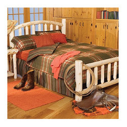 Rustic Cedar - Log Slat Bed - Add warmth and charm to your home or retreat with these cedar log beds. Each bed comes complete with headboard, footboard, and side rails. Note: All Rustic beds come with a headboard, footboard, and side rails. At an additional cost, metal support systems for double, queen, and king beds are available. King beds will NOT support California king mattresses or box springs. Bed dimensions are outside-to-outside, and may vary due to log size. Features: -Comes with headboard, footboard, and side rails.-Dimensions are outside-to-outside, and may vary due to log size.-King size will ship Truck Freight.-8'' clearance under bed.-About Cedar Cedar is the natural choice because of its beauty, practicality and durability. Rustic Cedar uses only the finest cedar to create furniture that lasts for generations. It is naturally resistant to decay, insect and weather damage. Because of this superior resistance, cedar is frequently used for outdoor fencing, and siding on homes. Cedar has an exceptionally high strength-to-weight ratio, which means that it is both durable and easy to move about. It does not shrink or wrap as many other woods commonly do. Unlike pressure-treated wood furniture, Rustic Cedar uses no chemical preservatives that may be harmful to your family's health. All cedar log furniture is subject to the natural process of checking as the wood ''seasons.'' Checking occurs as wood releases moisture across or through the annual growth rings and it does not affect the structural performance or integrity of the wood. Therefore cracks in Cedar furniture are quite normal and can happen at any time. The cracks can vary in sizes but are sure to not affect the quality or resistance of the product as this is a natural process of Cedar furniture..-Distressed: No.-Collection: Log.-Country of Manufacture: Canada.Warranty: -Manufacturer's 5 year limited warranty. About the Manufacturer: About Rustic Cedar Furniture Crafted with care in Quebec and Brit'
