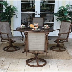 "Hospitality Rattan Chub Cay Swivel Slatted Patio Dining Set - Dark Bronze - Sure to be a big hit with anyone who appreciates both form and function, the Hospitality Rattan Chub Cay Swivel Slatted Patio Dining Set - Dark Bronze is just what you need to savor sparkling conversation and al fresco dining with friends. With a simple, yet elegant look that effortlessly blends classic style and contemporary aesthetics, this dining set, which includes four swivel rocking chairs and a 48-inch diam. slat-top table, is sure to be the highlight of any outdoor setting.Boasting a tubular extruded bamboo-look aluminum frame in a unique powder coated dark bronze finish that will not rust, the swivel chairs feature exclusive, custom-made Twitchell sling fabric, which is so comfy that it eliminates the need for cushions, seating you in luxurious comfort throughout your meal. Plus, it swivels so you can stay up to speed with all the conversations around you, even as the gentle rocking motion seats you in luxurious comfort throughout your meal. The dining table features a no-glass, slatted aluminum top that prevents water accumulation and offers plenty of space for four table settings. With the pieces being weather- and UV-resistant, you are assured of years of enjoyment, while the stackable design of the chairs makes off-season storage a breeze.Dimensions:Swivel rocking chair (each): 23W x 32D x 37H inchesDining table: 48 diam. x 29H inchesAbout Hospitality RattanHospitality Rattan has been a leading manufacturer and distributor of contract quality rattan, wicker, and bamboo furnishings since 2000. The company's product lines have become dominant in the Casual Rattan, Wicker, and Outdoor Markets because of their quality construction, variety, and attractive design. Designed for buyers who appreciate upscale furniture with a tropical feel, Hospitality Rattan offers a range of indoor and outdoor collections featuring all-aluminum frames woven with Viro or Rehau synthetic wicker fiber that will not fade or crack when subjected to the elements. Hospitality Rattan furniture is manufactured to hospitality specifications and quality standards, which exceed the standards for residential use.Hospitality Rattan's Environmental CommitmentHospitality Rattan is continually looking for ways to limit the impact on the environment and is always trying to use the most environmentally friendly manufacturing techniques and materials possible. The company manufactures the highest quality furniture following sound and responsible environmental policies, with minimum impact on natural resources. Hospitality Rattan is also committed to achieving environmental best practices throughout its activity whenever this is practical and takes responsibility for the development and implementation of environmental best practices throughout all operations. Hospitality Rattan maintains a policy of continuous environmental improvement and therefore is a continuing work in progress.Hospitality Rattan's Environmentally Friendly Manufacturing ProcessAll of Hospitality Rattan products are green. From its basic raw materials of rattan poles, peels, leather, bamboo, abaca, lampacanay, wood, leather strips, and boards, down to other materials like nails, staples, water-based adhesives, finishes, stains, glazes and packing materials, all have minimum impact to the environment and are safe, biodegradable, recycled, and mostly recyclable. Aside from this, the products have undergone an environmentally-friendly process that makes them """"greener."""" The company's rattan components are sourced from sustained-yield managed forests, which means that the methods used to grow and harvest the rattan vines ensure the long-term life of the forest and protect the biodiversity of the forest's ecosystems.Hospitality Rattan is committed to buying and using all materials, from rattan and hardwood to finishing materials, from reputable and renewable suppliers and seeks appropriate evidence that suppliers are in compliance with this policy. Hospitality Rattan strives to use materials that are processed in an environmentally responsible manner, or consist of a high level of recycled material. Finishing materials and stains used in Hospitality Rattan's furniture products consist of 75% water-based solutions which evaporate upon application with reduced or Volatile Organic Compounds (VOCs). The furniture factories use water-based glues, stains, topcoats and other finishes on all of their products. The switch from traditional solvent-based processes to water-based processes involved consolidating several processes by the factories, resulting in an 85% reduction in VOC emissions."
