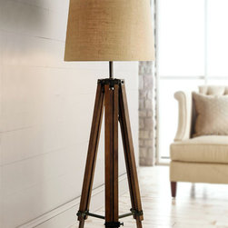Contemporary Wood Tripod Floor Lamps for Living Room - The Tripod Base Has An Oxidized Bronze Finish With Gold Undertones. The Round Hardback Shade Is An Off-white Linen Hardback.
