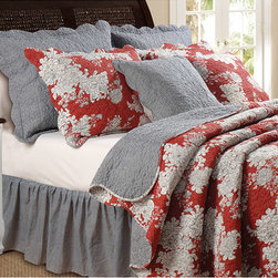 None - Lorraine Quilt Set - This quilt includes a beautiful black and white floral print on a bold red background. The quilt set also features vermicelli quilting and fabric-bound edges and can be reversed to reveal a coordinating traditional black and white gingham pattern.