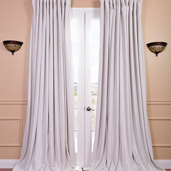 EFF - Off White Velvet Blackout Extra Wide Curtain Panel - Give any room a dramatic makeover when you hang this extra-wide curtain panel. The velvet texture and off-white color give extra depth and style to any room,while the convenient blackout lining keeps light out in the wee hours of the morning.