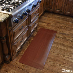 None - Comfort Style Wood Grain Cushion Mat (1'6 x 4') - This wood grain kitchen mat is a great fit for homes and offices with hardwood or laminate floors. Constructed from a durable PVC top with a comfortable sponge base,this mat will soothe tired feet whether in a commercial or home environment.