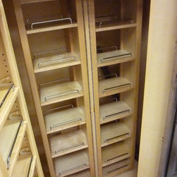 Hardware Resources - Super pantry with shelving installed on doors and swing out shelving for more storage at the back of the cabinet.