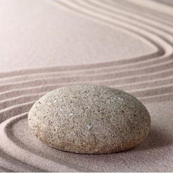 Zen Stone Wall Mural - A Zen garden is a stylized landscape with an artfully composed arrangement of rocks sand water and botanical plants. The sand is raked to symbolize waves contributing to the meditative nature of the arrangement. This Zen mural creates a feng-shui beauty on walls with a pleasing swirl of sand around a solitary rock.
