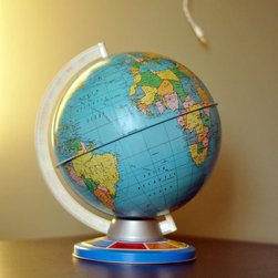 Vintage Globe by Green Hearts - A vintage globe makes for a fun decor accessory in a playroom because parents love remembering when they had a similar globe in their 4th grade classroom, and kids love exploring different countries and oceans right there. They also add color, visual interest and a source of fascination for both girls and boys.
