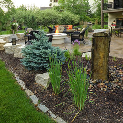 Fire and Water Compete - The basalt-column water feature and unique fire pit add the perfect touch to these outdoor living spaces.