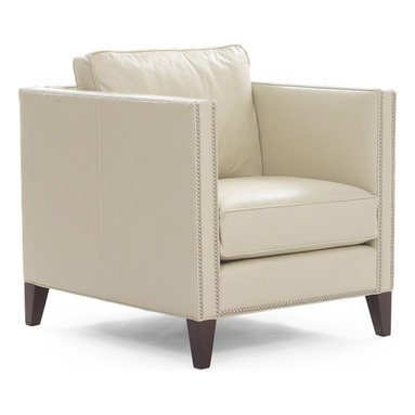 "Liam Chair - Our Liam chair has an updated, traditional silhouette with clean modern lines. This tailored, shelter arm style sofa has tall, slim arms, and double nail head trim wraps around the back of the sofa so it looks good from all angles. The high tapered legs ""lift"" the chair off the floor."