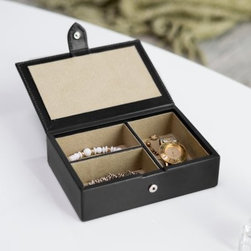 "Small Leather Jewelry Box with Snap Closure - 6.5W x 1.75H in. - Perfectly sized for traveling, this Small Leather Jewelry Box with Snap Closure - 6.5W x 1.75H in. provides an ideal way to stay organized – and stylish – on the road and works as a great gift idea for that well-traveled person in your life – particularly if that person happens to be you! Also a nice size for the dresser tops of those who aren't overly enamored with jewelry, the box comes with three storage compartments – one large and two that are smaller but of the same size, making it suitable for large accessories such as watches while also good for smaller pieces such as rings and necklaces. The box was constructed from classic Dakota smooth leather and is available in either black or red. Measuring 6.5 inches wide and nearly 5 inches deep, the jewelry box securely fastens with a snap stud tab closure on its outside. About Redd Leather:Conceived in the spring of 2006 and located in Melbourne, Australia, Redd Leather prides itself in the quality, design, functionality and style of its leather goods products. The company sells all things leather, from leather housewares and leather photo frames to leather travel accessories and leather storage products. Redd Leather's goods come in differing sizes and varying colors while employing several types of unique leathers, including croc prints, Nappa, full grain and quilted. As their website proudly states: ""We are leather. We hear leather. We heart leather."" See more at reddleather.com."