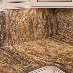 Rainforest Green Granite (Marble) - Rainforest Green Granite is a gorgeous stone quarried in India. It has brown/ burgundy/ purple tree-like veins coursing across a green background that can vary from hunter green to a neon green.