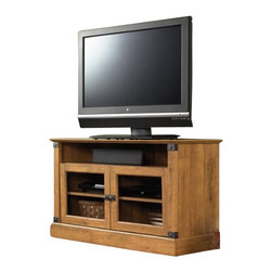 Sauder - Sauder Registry Row Panel TV Stand in Amber Pine - Sauder - TV Stands - 412268 - At home in any environment the classic Registry Row Collection from Sauder Woodworking is an inspired reworking of heritage styles from Industrial Age America. The warm Amber Pine finish recalls the unique character and color of recovered native timber. Riveted Iron finish accents and matching hardware complete the rustic look