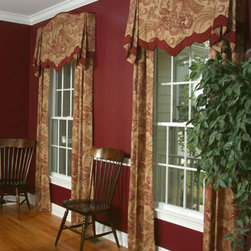 Window Treatments - Top Treatments - Custom hand-sewn Non-functioning panels under a board mounted arched top with contrasting detailed lower edge fabric, lined and interlined