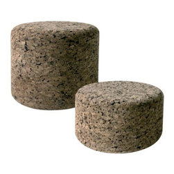 Moooi - Corks Stool by Moooi - Finally, fashionable furniture that floats. The Moooi Corks Stool is turned out of 100% agglomerate cork, retaining that material's distinctive tone and airy, buoyant texture. Available in two sizes, the Corks Stool is suitable as a stool, ottoman or small table in indoor applications. Designed by Jasper Morrison.Moooi creates modern pendant lighting, lamps, and a unique array of suspension lighting. Founded by Marcel Wanders and first presented in 2001, Moooi creates products that satisfy the customers' desire for individual style, and features designers such as Ross Lovegrove and Erwin Olaf.The Moooi Corks Stool is available with the following:Details:Made of agglomerate corkEngraved metal plate on undersideDesigned by Jasper Morrison, 2002Options:Size: High, or Low.Shipping:This item usually ships within 15 days.