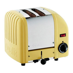 Dualit - Dualit 20298 Vario 2 Slice Classic Toaster-Yellow Multicolor - 20298 - Shop for Toasters from Hayneedle.com! The Dualit 20298 Vario Classic 2 Slice Toaster in canary yellow finish combines simplicity and sophistication perfectly. Designed for commercial use the toaster is hand-assembled in England and built to last with an insulated stainless-steel body variable controls and automatic turnoff. Complete with extra-wide 28mm slots to accommodate a Sandwich Cage award-winning ProHeat elements and a patented design that increases toasting efficiency and element longevity. Every toaster has a removable crumb tray and an adjustable rear foot. The Sandwich Cage which has a built-in drip tray can be purchased as an optional accessory. Additional Information:Measures 10W x 8D x 9H inchesMade in England About DualitFrom the first flip-sided toaster in 1946 through the steady growth of a commercial product range in the 1950s and 60s to its explosion onto the consumer market in the late 70s Dualit has remained true to its founder Max Gort-Barten s original vision. A company with a clear set of values Dualit remains focused on high quality well-engineered products a hard-won reputation amongst professional chefs and a loyal and family-orientated workforce. Dualit continues to grow by remaining true to the same spirit of invention entrepreneurship and gut instinct and by identifying what its customers need by fulfilling that need and by exceeding their expectations.