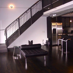 Monochromatic Color Installations - Meisel's Design was contracted to do this Loft Space in downtown Houston.  This space is not complete. We ordered a great area rug for the living area and punched the project with some great color.