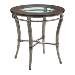 Stein World Verona Round Metal with Wood and Glass Top End Table - Even if the Stein World Verona Round Metal with Wood and Glass Top End Table becomes the table by the door where you put your keys, wallet, and phone when you come home, it will still be the best looking key/wallet/phone table in the neighborhood. No matter where it ends up, you'll enjoy the solid ash top with its select wood veneers and deep, historic finish. The iron frame has a textured finish that looks like authentic, weathered wrought iron while a single sheet of tempered and beveled glass adds a light, polished look to this functional piece.About Stein WorldStein World is dedicated to discovering and bringing to the market place the finest hand-painted products from around the world. With over 50 years of experience, they have been able to develop not only the resources but true partnerships with quality manufacturers and artisans who make Stein World unique in the furniture industry today. Their commitment to you is to present only the highest quality furniture at prices that bring future family heirlooms into everyone's price range.