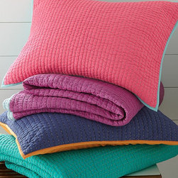 Flip-Side Reversible Quilt & Shams - Whether it's Side A or Side B, this colorful reversible quilt, offering two bold looks in one, is always a hit. Airy cotton voile front and back with pure cotton fill. Hand-quilted stitching and contrast binding for added pop.