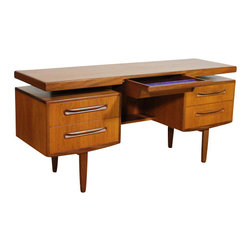 G Plan - Consigned MidCentury Teak Floating Desk by G-plan. Gommes. Kofod Larsen, Vintage - Stunning G Plan Fresco Floating Desk in Teak and Walnut. Circa 1960's.  Offered is a beautiful and sought after Teak Floating Desk by the British Furniture Company G-Plan, part of their Fresco Line.  This stunning desk designed by V B Wilkins for G Plan has 2 drawers either side underneath a floating top with a center smaller drawer. Can also be used as a dressing table. More Pictures available - just ask.  G-Plan was a pioneering range of furniture in the United Kingdom, produced by E Gomme Ltd of High Wycombe with designers including V B Wilkins and Kofod-Larsen who designed their Danish Line of furniture.  Now very sought after and hard to find in the US.